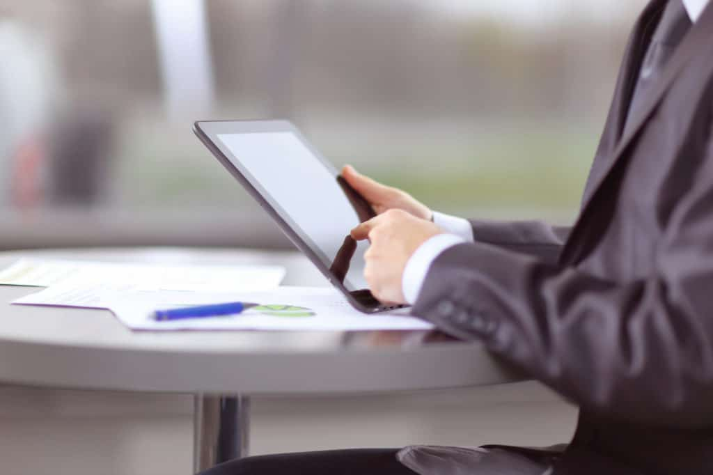 close up. businessman tapping the screen of digital tablet