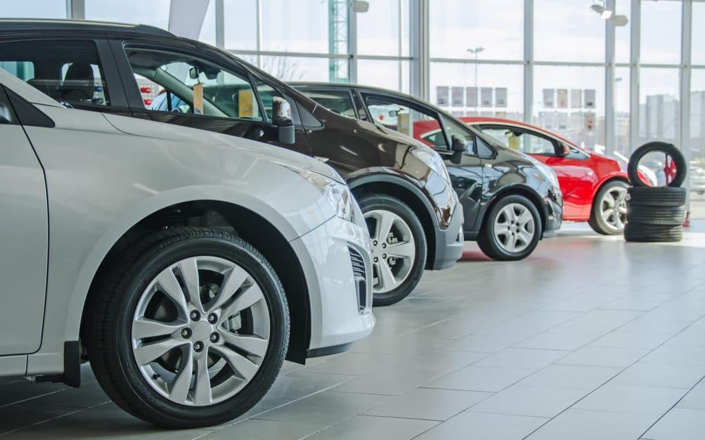 Several new cars at dealership showroom
