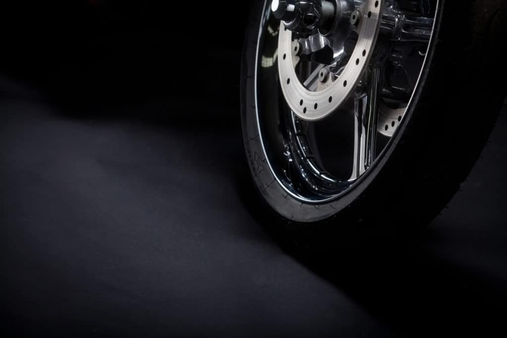 closeup of motorcycle wheel and tire