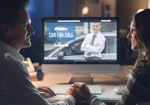Young couple buying a car online